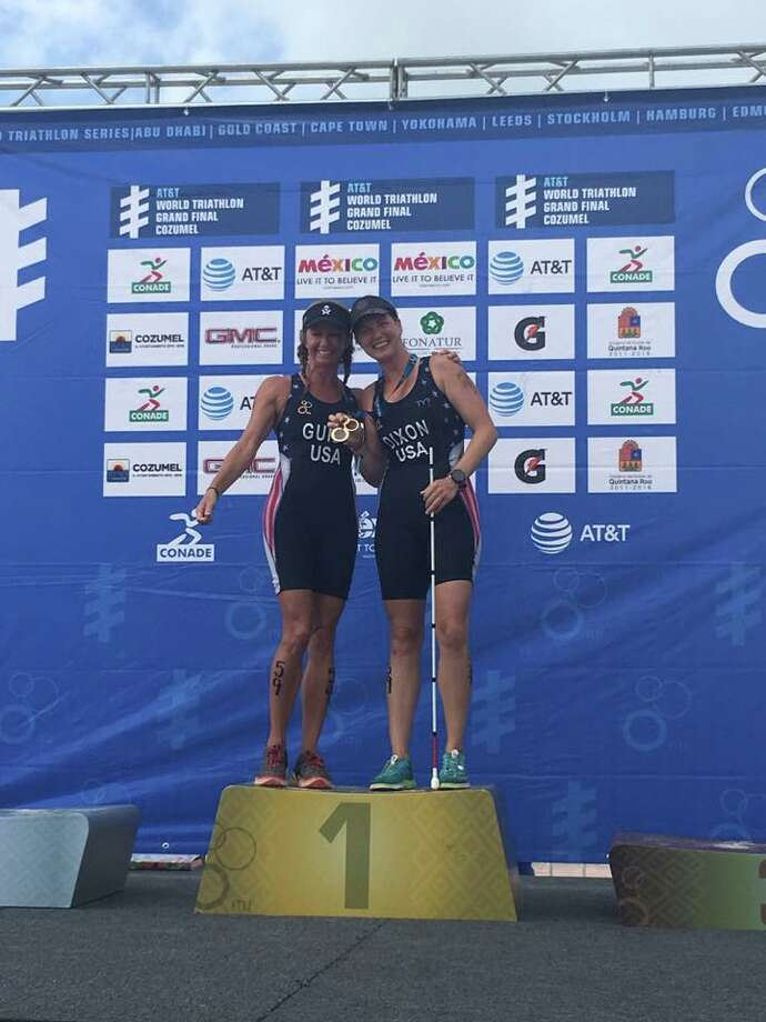 Amy Dixon of Greenwich, right, and Christy Favrhow Fritts, show off the gold at the ITU Triathlon World Championships in Mexico. Photo: / Contributed