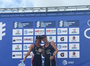 Amy Dixon of Greenwich, right, and Christy Favrhow Fritts, show off the gold at the ITU Triathlon World Championships in Mexico.