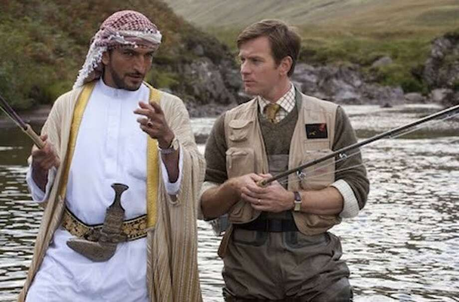 """Amr Waked and Ewan McGregor in """"Salmon Fishing in Yemen."""" Movie reviewer Sally M. Hill says the odd movie works because of its likeable cast."""