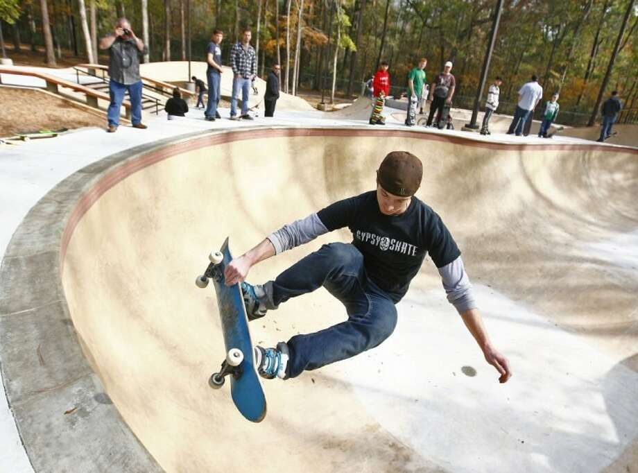 Dutch Meier uses the skate bowl at Kasmiersky park in Conroe to catch some fresh air and perfect his landing technique. Additional amenities include two pavilions, restroom facilities, athletic field, picnic area, half-mile jogging and walking trail, tennis courts, basketball courts, a handball court and exercise stations Photo: Staff Photo By Karl Anderson