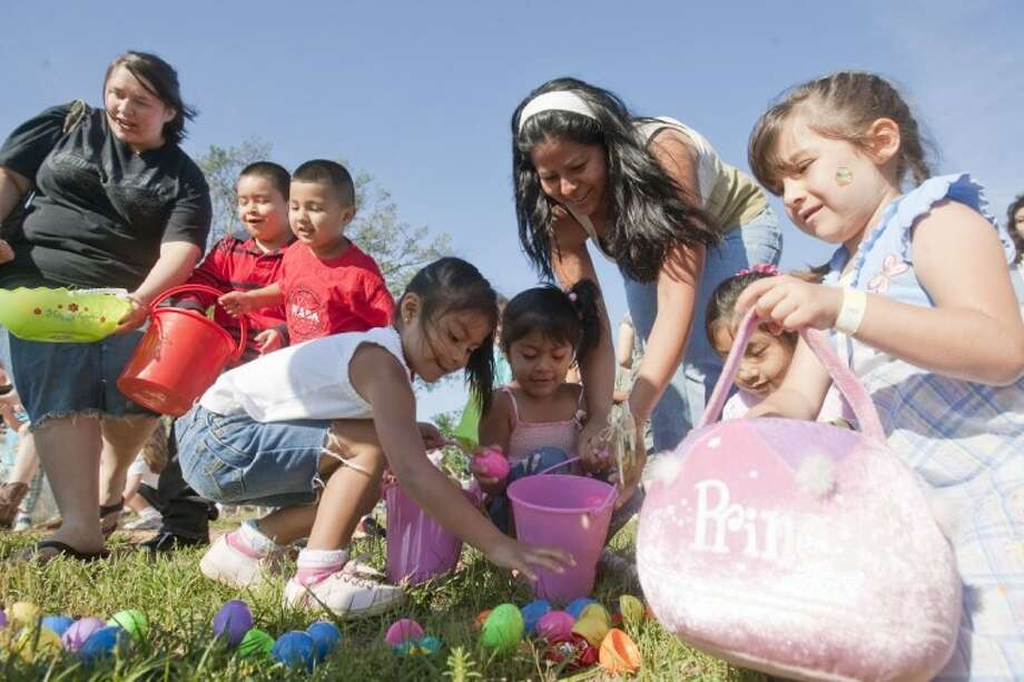 Children hunt for Easter eggs during the First Baptist Church 'Easter Eggstravaganza' at Carl Barton Park on Saturday. Photo: Karl Anderson