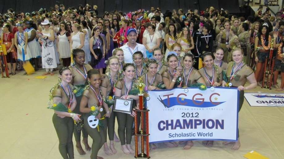 The Oak Ridge High School varsity color guard won the Texas Color Guard Circuit state championships in scholastic world competing class Sunday at Pearland High School. The 2012 winter guard season members are: front row, left to right, sophomore Tatyana Smith, officer and senior Rebecca Gamble, captain and senior Sarah McBride, junior Lauren Brummett, junior Steffy Martinez, junior Amme Sanchez, junior Faith San Miguel-Briggs and junior Emily Taylor. Second row: sophomore Alex Perez, freshman Ashley Banks, junior Jessica Reade, freshman Shawnee Bautista, freshman Emily DeLage, 8th grader Lindsey Taylor and 7th grader Haley Perez. In the back is Oak Ridge Color Guard Director Tom Harrington. Senior captain Sarah McBride was also one of three recipients selected from across the state for a TCGC scholarship. Photo: Courtesy Photo