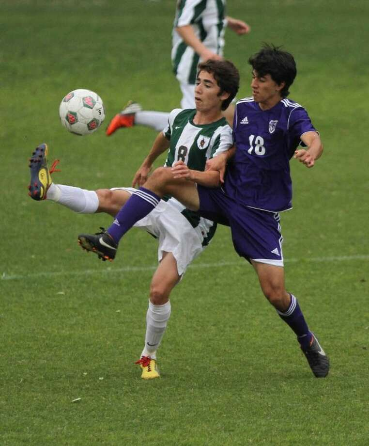 The Woodlands midfielder Marcelo Tamez, left, and the Highlanders will face McKinney Boyd in the Region II-5A Tournament on Friday. Photo: Staff Photo By Jason Fochtman