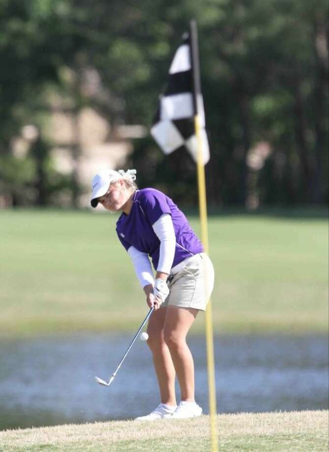 Montgomery's Kallie Gonzales chips onto the green on the 18th hole during the District 18-4A Tournament on Thursday at Oakhurst Golf Club in Porter. To view or purchase this photo and others like it, visit HCNpics.com. Photo: Staff Photo By Jason Fochtman
