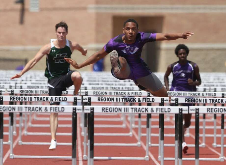 Willis' Quan West competes in the boys 110-meter hurdles during the prelims of the District 18-4A track and field meet at Turner Stadium Tuesday in Humble. Photo: Jason Fochtman