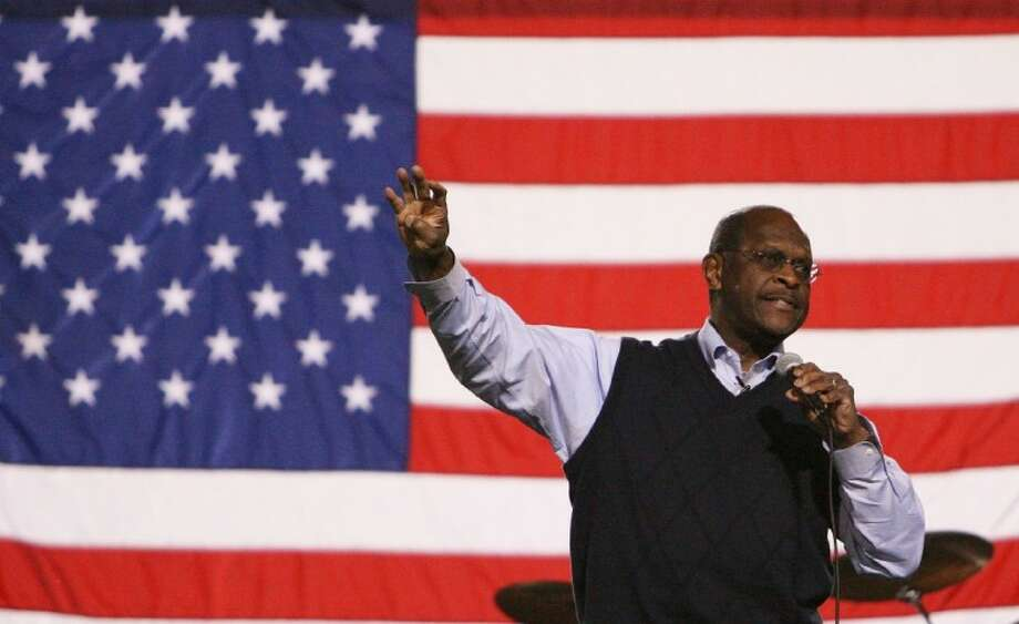 Herman Cain speaks to the crowd during the Tax Day Tea Party April 16 at Woodforest Bank Stadium. Cain has launched a presidential exploratory committee.