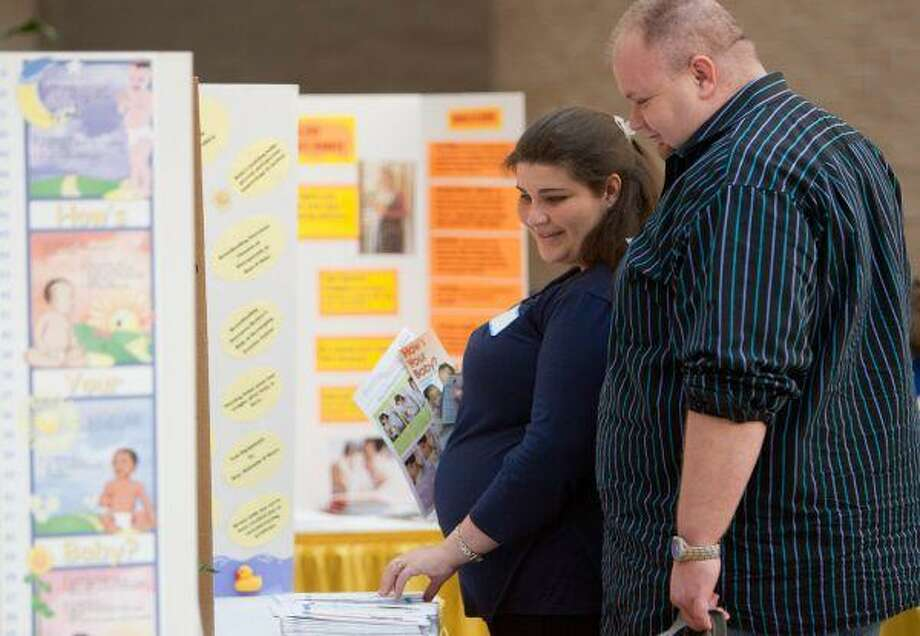 Brett and Kimberly Robbins, of Willis, browse the booths a the My Fair Baby event Saturday at the Conroe Regional Medical Center. The event provided a multitude of information for new and expecting mothers. / The Courier