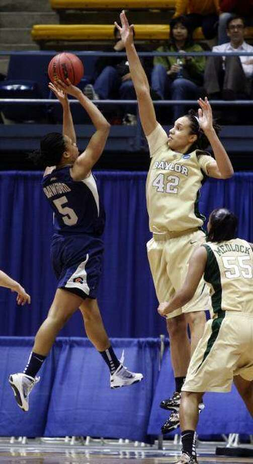 Baylor's Brittney Griner reaches to block the shot of Georgetown's Adria Crawford during an NCAA second-round tournament game late Monday night in Berkeley, Calif. / AP2010