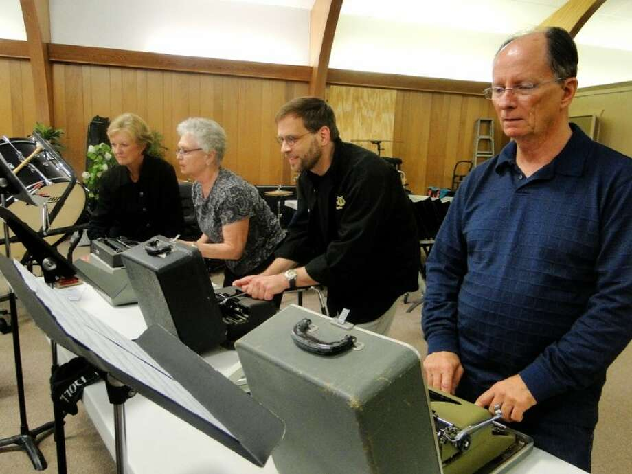 "The Conroe Symphony Orchestra's percussion section rehearsing Leroy Anderson's ""The Typewriter"" for the Monday CSO concert at The Ark Church in Conroe. Pictured from left to right are Micki Smith, Karen Greer, Bob Kissner and Jim Hyden. Not pictured is Percussion Principal Zach Zirk."
