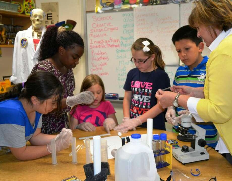 WISD students (L to R) Safira Reyes, Selma Nieniel, Leiloni Zachary, Kalysta Guitierrez and Daniel Perez and teacher, Janet Lindsey, prepare their cabbage seed space experiment to travel to the International Space Station.