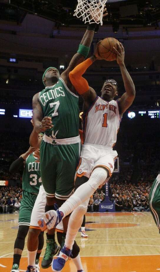 The Knicks' Amare Stoudemire drives past the Celtics' Jermaine O'Neal during the first half of Game 3 on Friday.