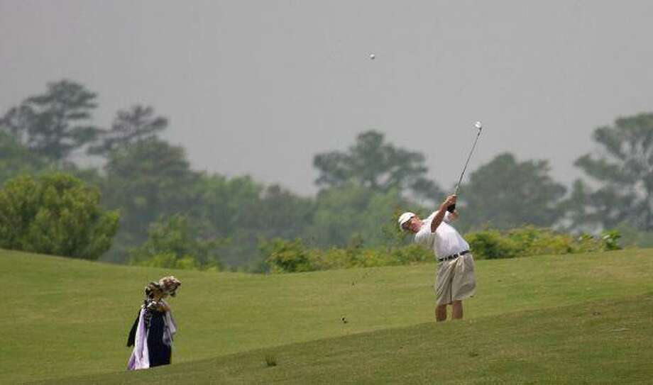 Montgomery's Will Young hits on the 18th green during the final round of the Region III-4A Tournament at Raven Nest in Huntsville. / The Courier