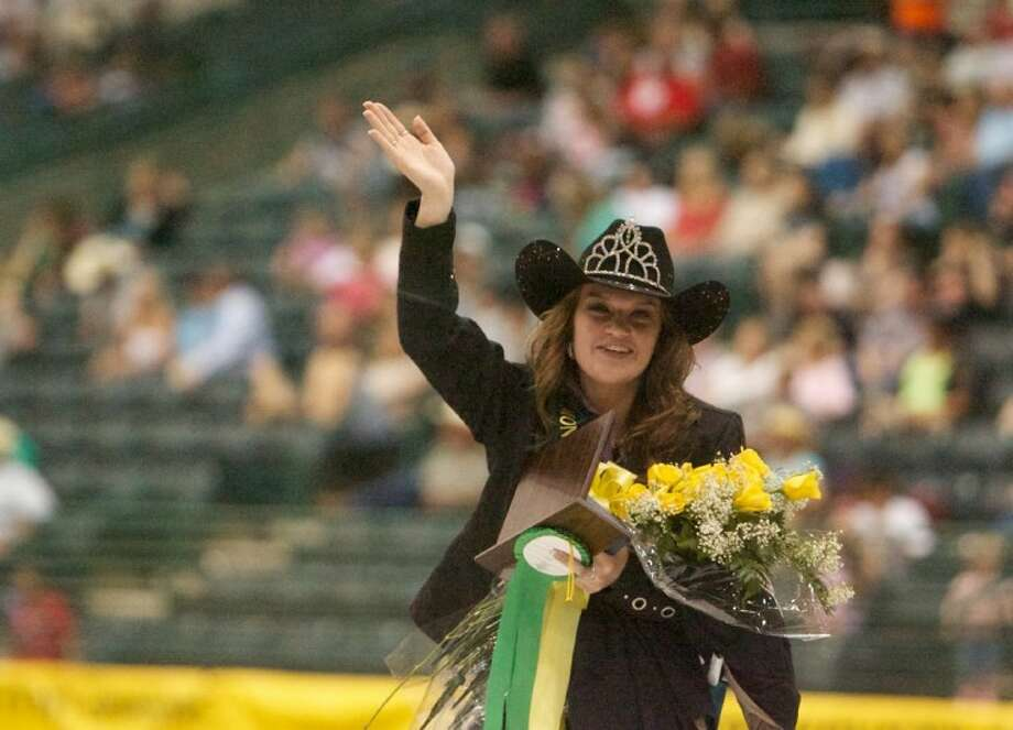 Conroe High School student Tori Merryfield, 16, waves to the crowd after being announced as the 2012 Montgomery County Fair Queen during Saturday night's rodeo event at the Montgomery County Fairgrounds in Conroe.