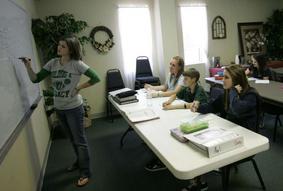 Mrs. Carrico, an upper school math teacher, teaches a class at Legacy Prep in The Woodlands.
