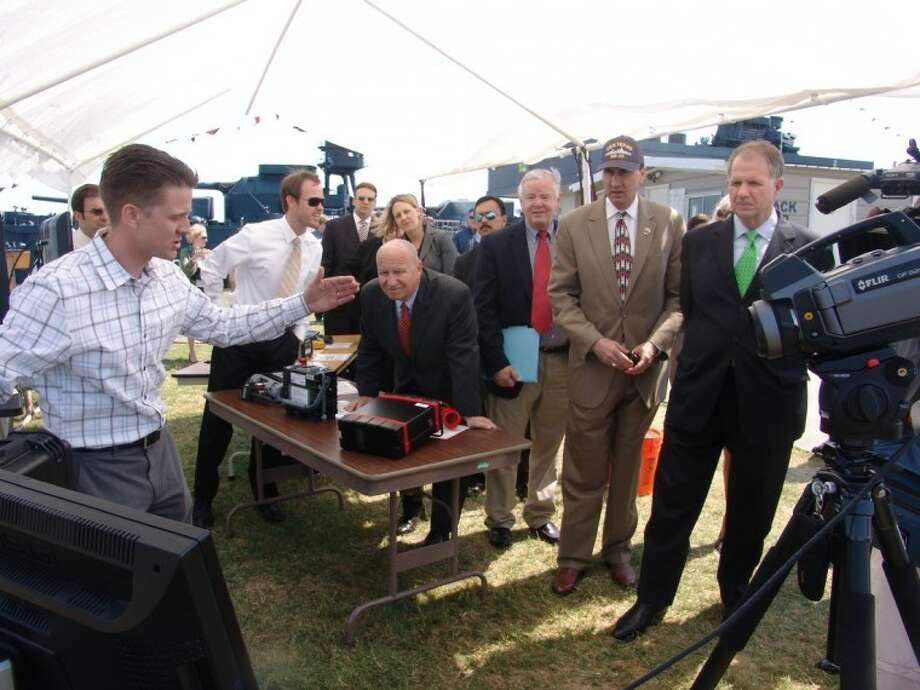 """(From right) Congressmen Ted Poe, Pete Olson, Joe Barton and Kevin Brady watch the demonstration of a camera that """"sees"""" chemicals invisible to the human eye. They were at the Houston Ship Channel to learn how the Texas Commission on Environmental Quality monitors air pollution."""