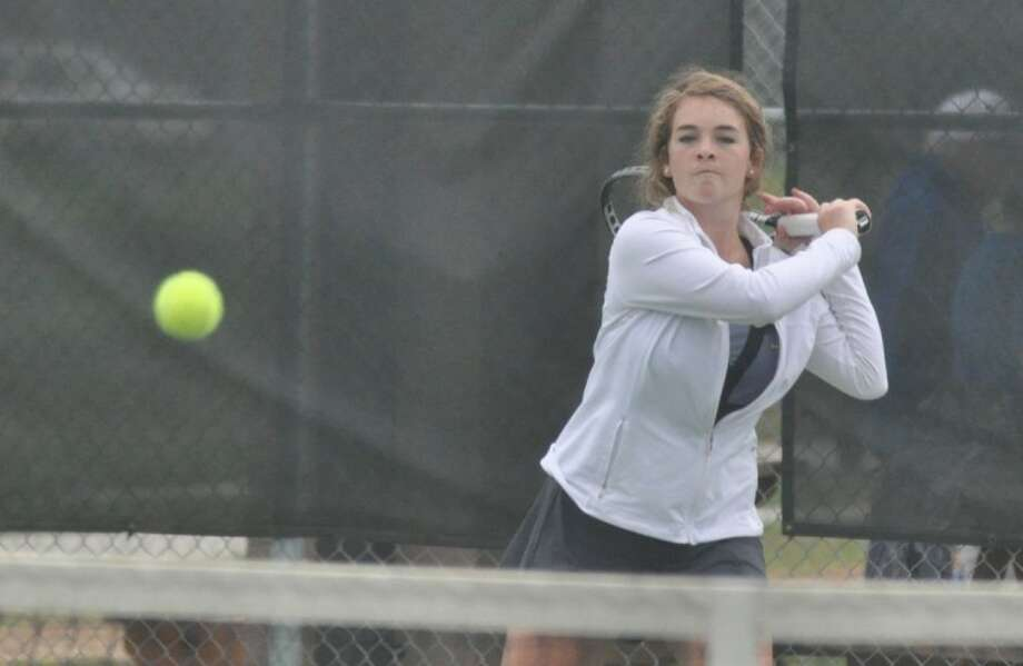 Montgomery's Dana Glaser returns a shot during a mixed doubles match at the Region III-4A tournament in Willis on Monday. Photo: Keith MacPherson
