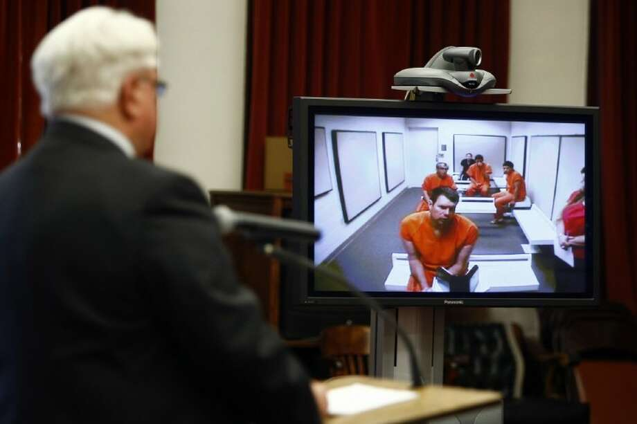 Former NFL quarterback Ryan Leaf makes an initial court appearance before Cascade County District Judge Dirk Sandefur via video link as his defense attorney, Eric Olson, listens at left, Monday in Great Falls, Mont. Photo: Larry Beckner