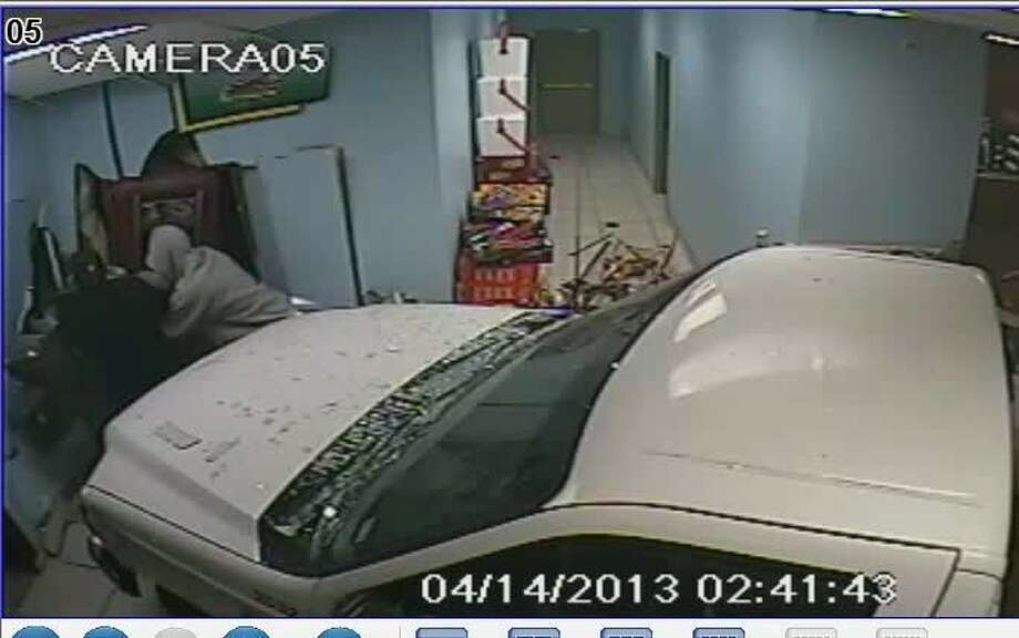 Detective with the MCSO are looking for three men who stole a white work truck and smashed through the front of a convenience store to steal an ATM machine.