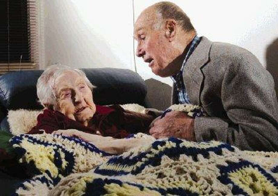 In this Oct. 20, 2009 file photo, Neva Morris, from Ames, talks to her grandson-in-law Tom Wickersham at North Crest Community in Ames, Iowa. Morris, the oldest person in America, died at a nursing home in Ames early Tuesday. / AP2009