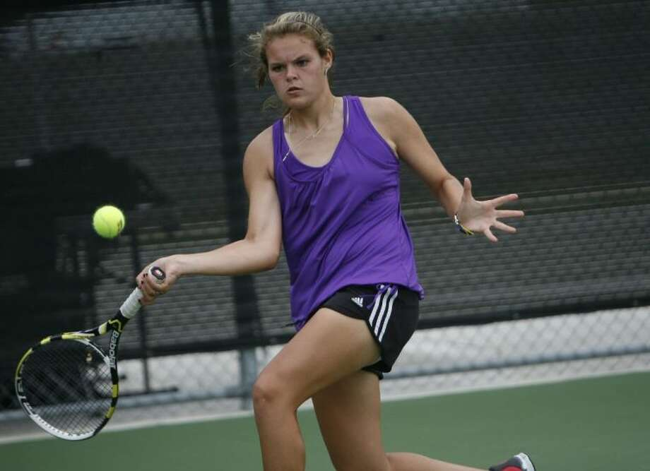 Montgomery's Erika Richarme chases down a ball in the corner during a doubles match in the Region III-4A Tournament on Wednesday at the Blythe Calfee Tennis Center in Willis. To view or purchase this photo and others like it, visit HCNpics.com. Photo: Staff Photo By Eric Swist