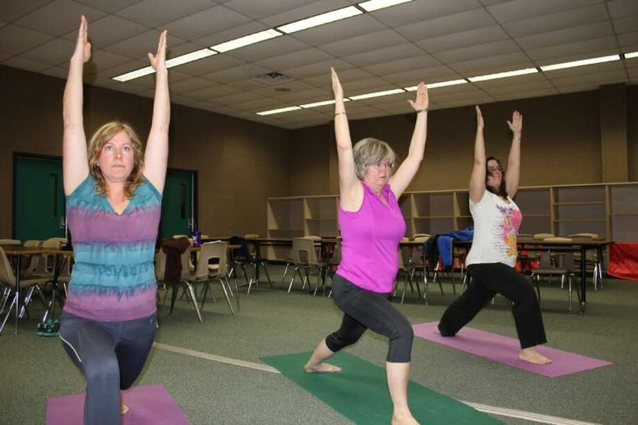 C.C. Hardy staff members participate in a yoga class at the school. The class is just one of the initiatives to help students and staff achieve a healthier lifestyle.