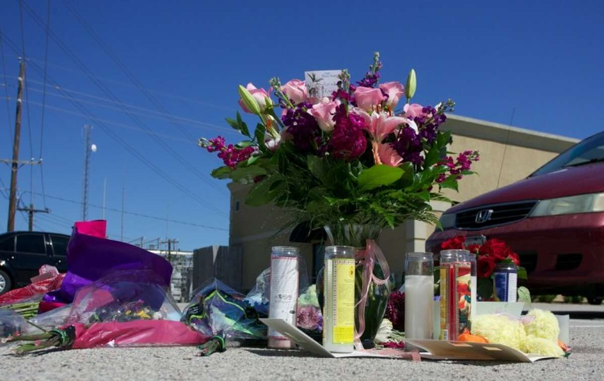A makeshift memorial for murder victim Kayla Golden, 28, is seen in the parking lot of the Northwoods Pediatric Center where Golden was gunned down Tuesday in The Woodlands.