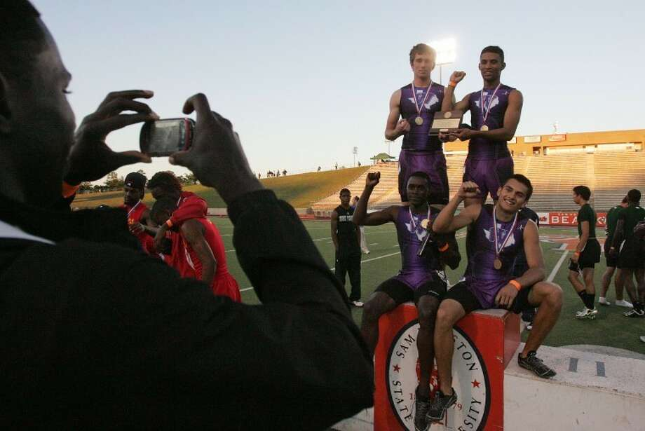 A friend snaps a photo of the Willis High School 4x400-meter relay team, clockwise from top left, Brad Abbott, Jose Torres, Brian Burkhardt and Chris Platt, after the team took first place in the event at the Region III-4A Track and Field meet at Bowers Stadium in Huntsville Tuesday. The Wildkats earned a trip to state with the victory. See the regional track and field stories in today's Sports section.