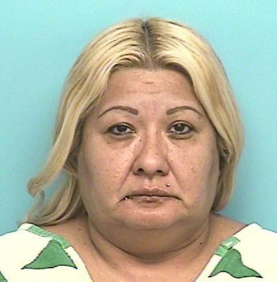 """CADENGO, Esmeralda HinojosaWhite/Female DOB: 07/14/1964Height: 5'05"""" Weight: 230 lbs.Hair: Blk/Bln Eyes: BrownWarrant: # 120303103 Capias Poss. w/intent to Deliver X's 3LKA: S. 3rd Street, Conroe."""