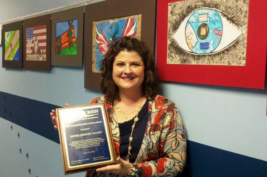 Covenant Christian School art teacher Renee Adams, flanked by student artwork, poses with the 'Outstanding Educator' award plaque she received from former First Lady Barbara Bush last week at the Bush Presidential Librarby and Museum in College Station.