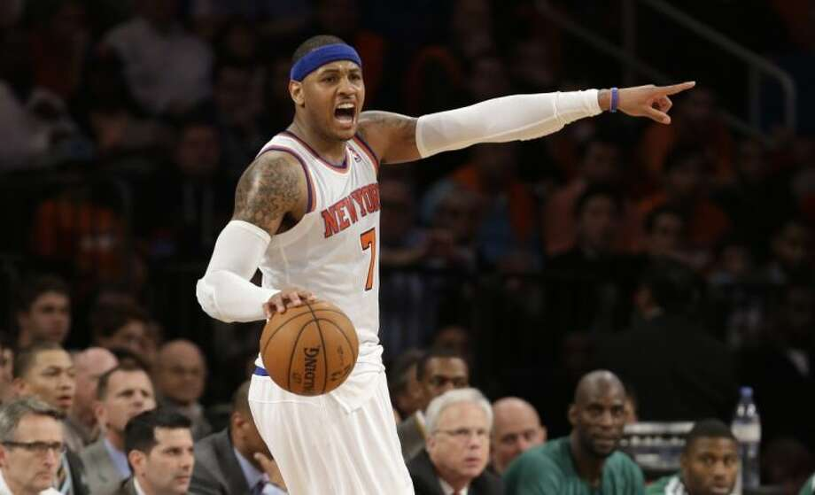 New York Knicks forward Carmelo Anthony reacts toward a referee after a teammate was called for a foul in the second half of Game 1 against the Boston Celtics on Saturday in New York. Photo: Kathy Willens
