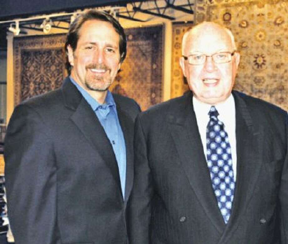 Terry McBurney, principal of Republic Payment Systems, stands with longtime client Don Mudd, of Woodlands Oriental Rug Gallery. Republic Payment Systems is located at 1610 Woodstead Court, Suite 150, in The Woodlands. For more information, call 281-719-0769 or visit www.republicpayment.com.