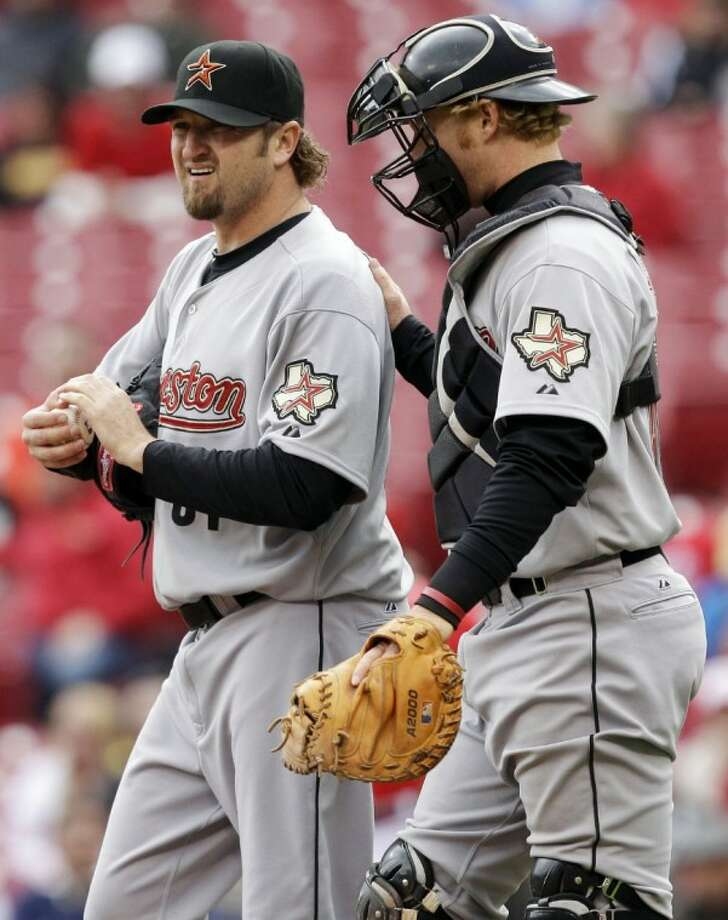 Houston Astros relief pitcher Brandon Lyon, left, talks with catcher J.R. Towles in the ninth inning against the Cincinnati Reds on May 4 in Cincinnati. Lyon gave up three runs in the inning and was the losing pitcher in the game won by Cincinnati 3-2. Photo: Al Behrman