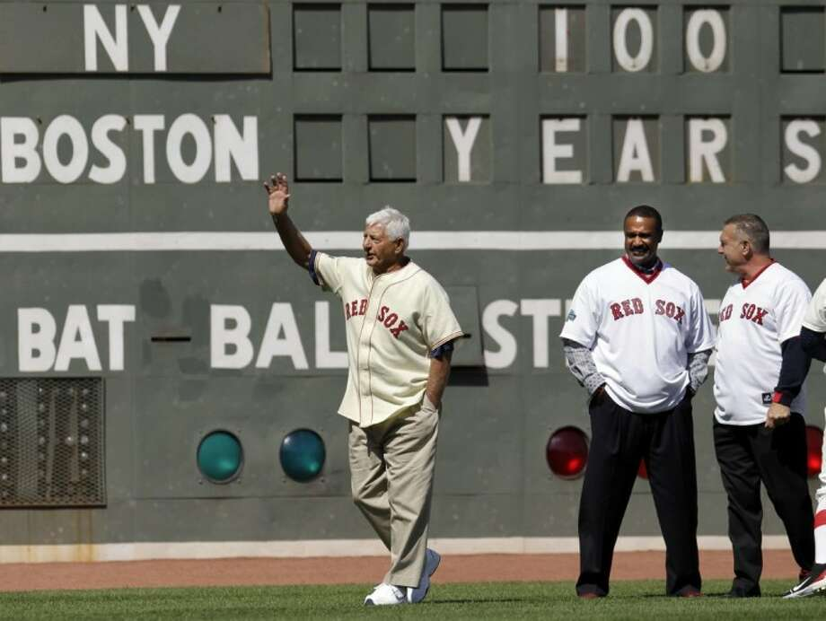 Former Boston Red Sox player Carl Yastrzemski waves to fans as fellow former left fielders Jim Rice left, and Bernie Carbo look on at Fenway Park in Boston, Friday, during a celebration of the 100th anniversary of the first regular-season game at Fenway Park prior to a baseball game against the New York Yankees. Photo: Elise Amendola