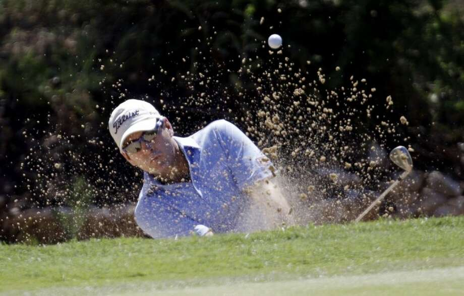 Ben Curtis hits from a sand bunker on the first hole during the third round of the Texas Open golf tournament Saturday in San Antonio. Photo: Eric Gay