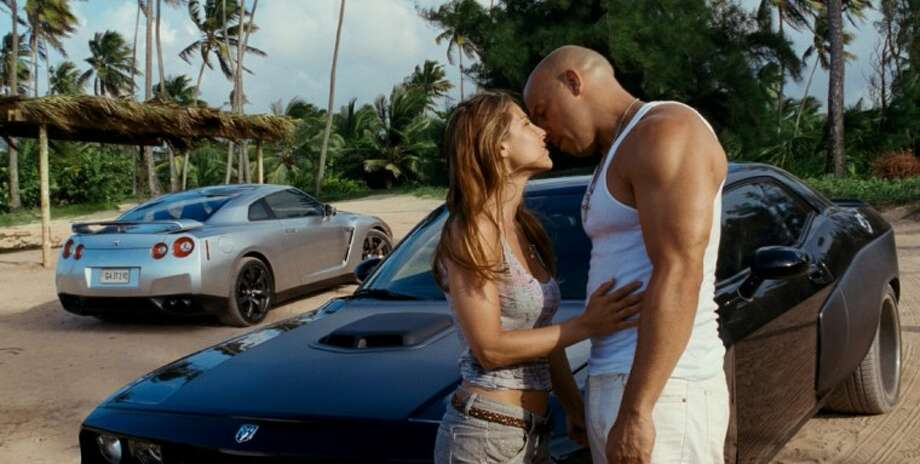 """In this film publicity image released by Universal Pictures, Elsa Pataky, left, and Vin Diesel are shown in a scene from """"Fast Five."""""""