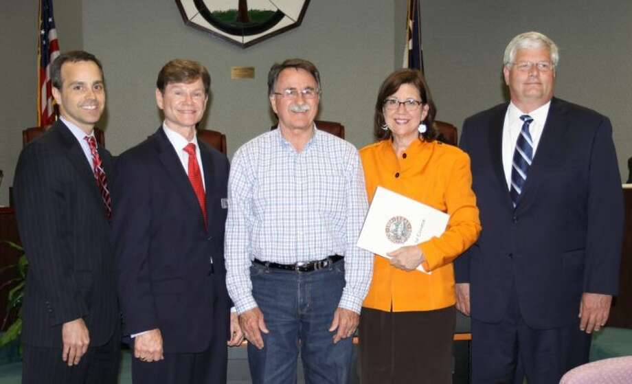 Conroe Mayor Webb Melder, middle, proclaimed April as Child Abuse Awareness and Prevention Month. Pictured, left to right, are CASA of Montgomery County board members Bill Friebel, chairman, Daniel Vertrees, Ann McAlpin, CASA executive director, and Cliff Hazel, development director.