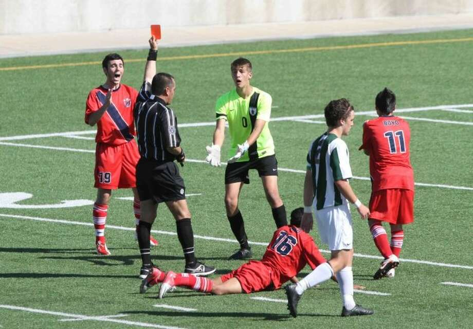 The Woodlands goalkeeper Simon Böhme reacts after getting a red card in the first half during a Region II-5A semifinal match Friday at Kelly Reeves Athletic Complex in Austin. To view or purchase this photo and others like it, visit HCNpics.com. Photo: Staff Photo By Jason Fochtman