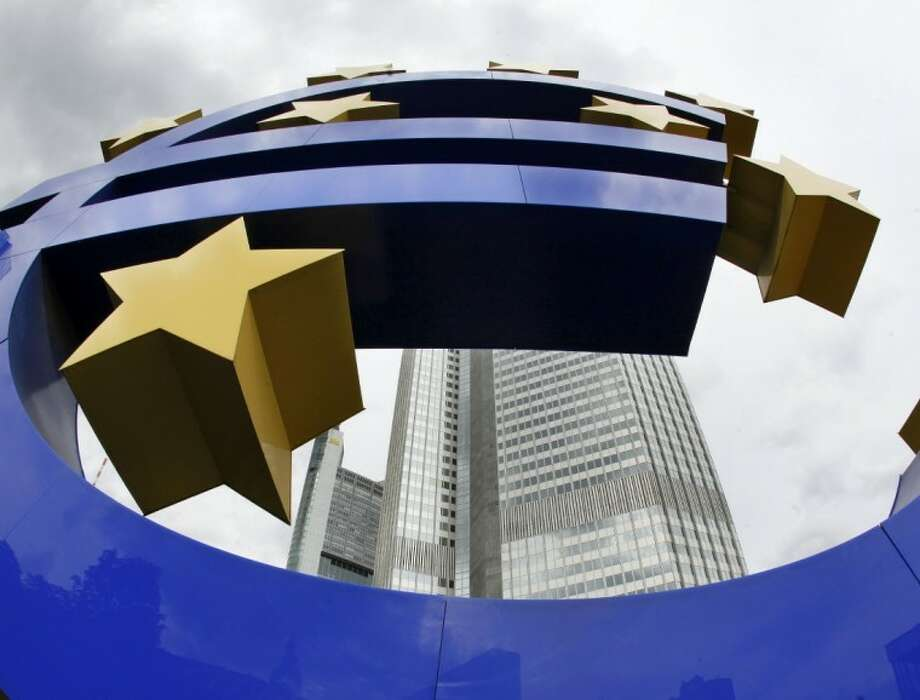 In this Sept. 2, 2009 file picture, the Euro sculpture is photographed in front of the European Central Bank ECB in Frankfurt, central Germany. The European Central Bank says the flow of credit to businesses grew more slowly in February - a sign that the bank's massive loans to the financial system have yet to kickstart a lagging eurozone economy. Photo: AP Photo