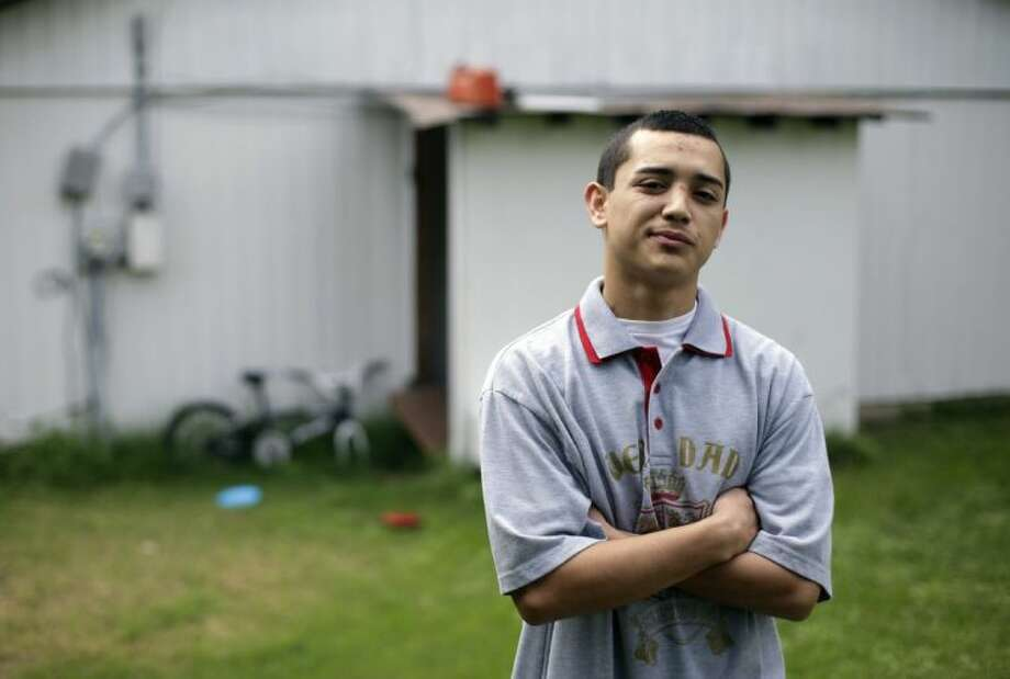 In this Thursday, April 18, 2013 photo, Pete Garanzuay, 18, poses for a photo at his home, in Austin, Texas. Garanzuay, who first entered a detention center five years ago at age 13, spent 36 hours locked in solitary confinement at a juvenile detention center in Travis County. Across the state, records show, juvenile detention centers locked children in solitary confinement more than 35,000 times last year. Photo: Eric Gay