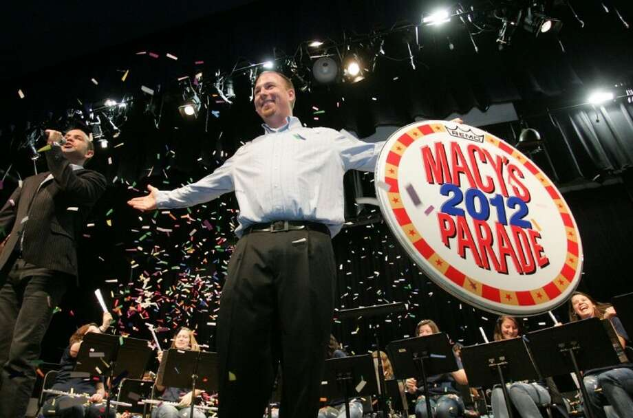 Oak Ridge High School band director Jack Allen, right, celebrates May 5 as Wesley Whatley, left, associate creative director for the Macy's Thanksgiving Day Parade, announces that the school's band will perform in the parade in 2012 in New York City. The announcement came as a surprise to both faculty and students. Oak Ridge is among 11 high school bands across the nation selected to perform in the parade.