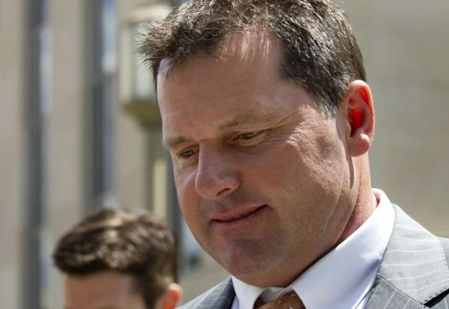 Former Major League Baseball pitcher Roger Clemens leaves federal court in Washington, Tuesday. Clemens' lawyer opened his defense of the former pitching star by telling jurors that evidence purportedly showing Clemens used steroids was manipulated by his former strength coach, Brian McNamee. Photo: Manuel Balce Ceneta