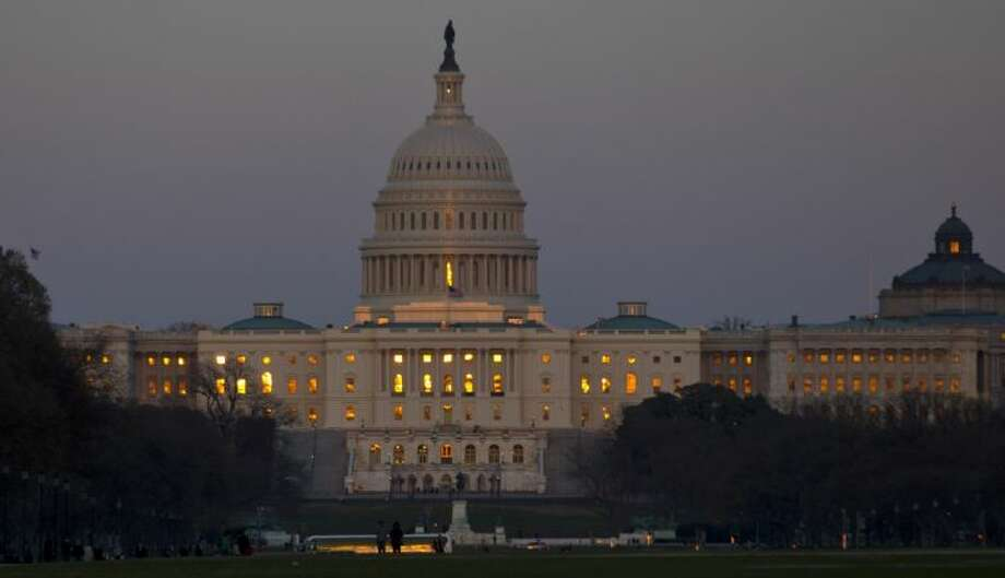 The setting sun is reflected in the windows of the U.S. Capitol onSaturday. Photo: Alex Brandon