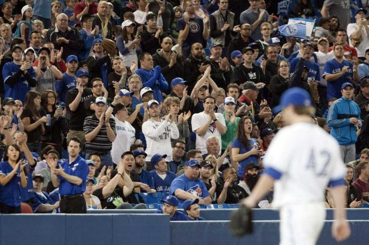 Toronto Blue Jays starting pitcher Kyle Drabek receives a standing ovation from Blue Jays fans as he is relieved during the eighth inning of Sunday's game against the Baltimore Orioles in Toronto.