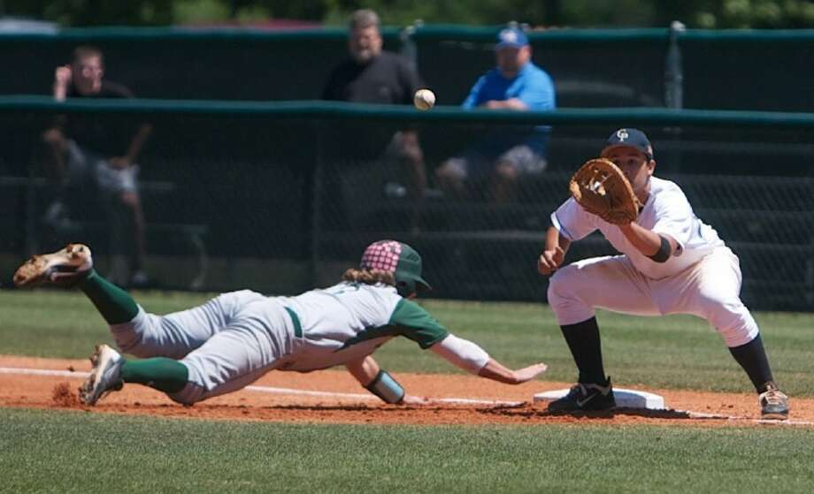 The Woodlands' Lance Miles dive back to first base as College Park first baseman Parker Stevens attempts to make a play during Saturday's game in The Woodlands. Miles was called safe on the play. Photo: Staff Photo By Eric S. Swist