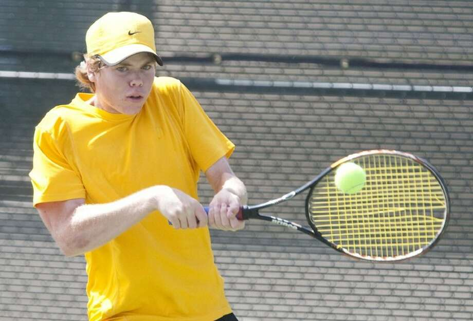 Montgomery's Brad Henkelman plays in a match against Dawson's Cody Blanchard during the Region III-4A Tennis Championships at Blythe Calfee Tennis Center in Willis. Photo: Karl Anderson