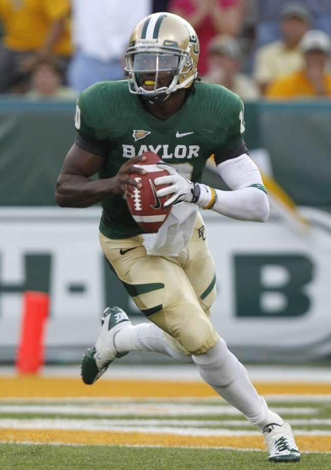 Former Baylor quarterback and Heisman Trophy winner Robert Griffin III is expected to be selected second overall by the Washington Redskins in tonight's NFL draft. Photo: LM Otero