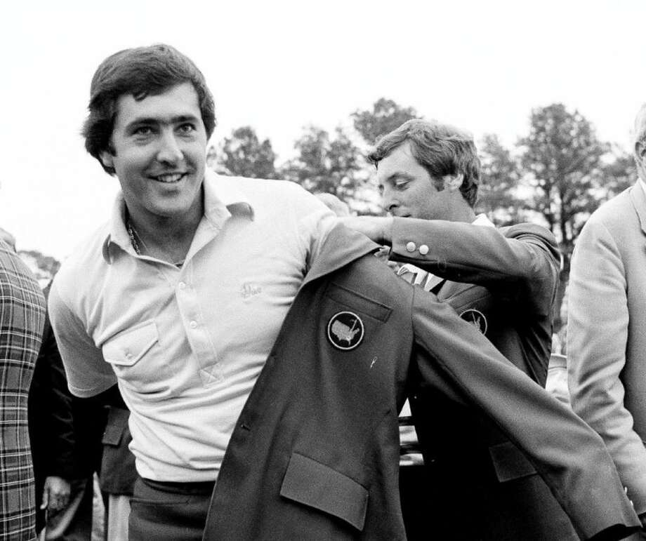 Seve Ballesteros, left, is helped with his Masters green jacket by the previous year's winner, Fuzzy Zoeller, after winning the 1980 Masters in Augusta, Ga.