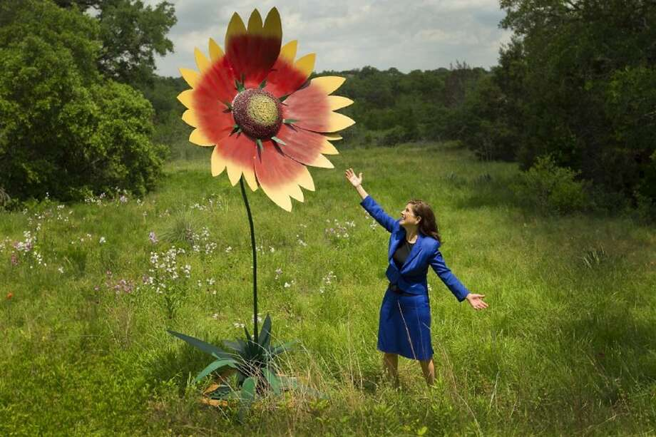 Luci Baines Johnson, daughter of Lady Bird Johnson and former President Lyndon Baines Johnson, poses for a photo at the wildflower center in Austin April 12. Photo: Ralph Barrera
