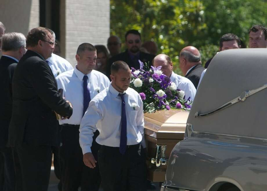 Pallbearers carry out the casket of Kala Marie Golden-Schuchardt following funeral services at the First Baptist Church of Willis on Tuesday. Photo: Staff Photo By Eric S. Swist