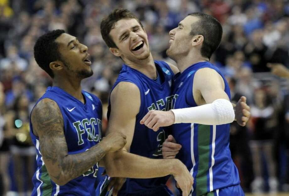 Florida Gulf Coast players Dajuan Graf, from left, Eddie Murray and Brett Comer celebrate after defeating San Diego State 81-71 in the NCAA Tournament. Photo: Michael Perez